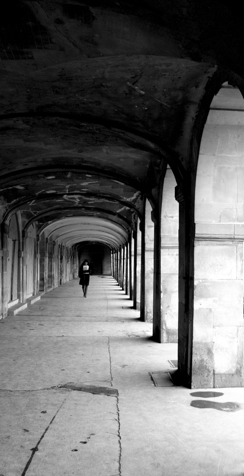Woman walking at Place Des Vosges